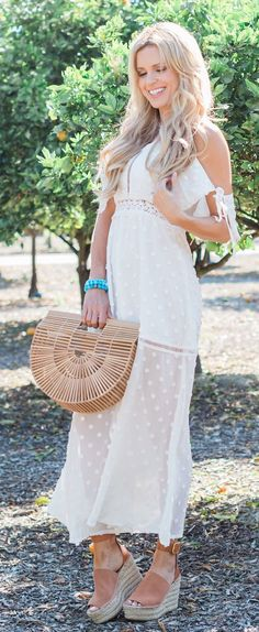 #spring #outfits White Dotted Maxi Dress & Wood Clutch