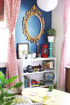 Love the blue wall and curtains!