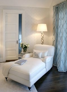 The splash of blue in the curtains adds an awesome pop of colour, whilst the pallet of the room remains white and crisp