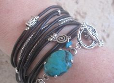 Boho Chic Dark Brown Leather Wrap Bracelet with Turquoise Stone & Silver Accents. $55.00, via Etsy.