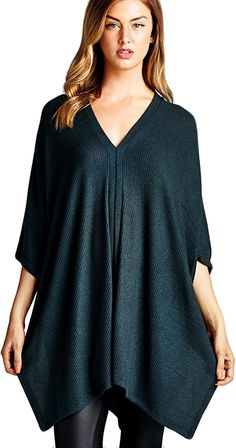 This over sized pullover tunic is the clothing version of a messy bun, stylish yet effortless. •Boxy fit •Elbow length sleeves •Scoop V-neck •Center and back seam detailing •Soft, fuzzy, ribbed texture fabric •Fabric : 21% Polyester, 76% Rayon, 3% Spandex •Made in USA