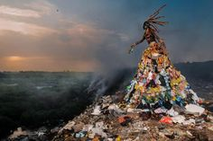 Fabrice Monteiro is a Benin photographer. This particular piece of African art by Monteiro was shot in Mbeubeuss, once one of Senegal's green marsh districts. Africa Day, West Africa, Senegal Africa, Photo Choc, Viviane Sassen, Reportage Photo, Grand Palais, Photo Series, Planet Earth
