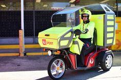 Postman Craig Patrick riding a three wheel electric vehicle Electric Cars, Electric Vehicle, Third Wheel, Car Wheels, Office Table, Table Desk, Future Car, Brisbane
