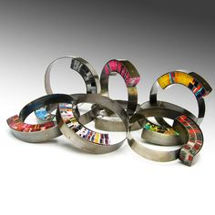 """Francesca Vitali - """"Sheller bracelets""""  Sterling silver with recycled magazine pages"""