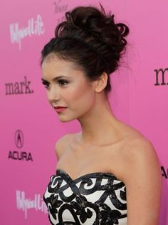 We love this high bun look for a wedding or formal event.