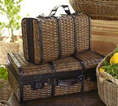 """$119.00 Woven Suitcase #potterybarn  Voyagers on the great steamships of the early 20th century packed their belongings in wicker suitcases like these. Handcrafted from split rattan & wood, with leather handles and bronze-finished metal latches, our careful reproductions make fitting homes 4 travel mementos, letters & more.  Small: 18"""" wide x 10.5"""" deep x 6.5"""" high  Large: 23"""" wide x 16.5"""" deep x 8"""" high  Made of handwoven rattan with stained mahogany wood & leather handles.  Decorative use…"""