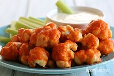 Spicy Buffalo Cauliflower Bites - Hot and spicy cauliflower bites, battered and baked and smothered with hot sauce. #weightwatchers