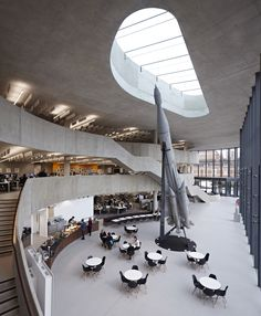 A decommissioned Soviet rocket is the centrepiece for this sculptural cast-concrete office in York, England, designed by Make Architects for insurance company Hiscox.