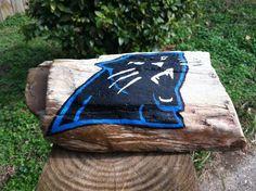 Hand Painted Carolina Panthers logo on Mississippi Petrified Wood.         #artsandcrafts #petrifiedwood #fossil #rock #minerals #handpainted #originalart #nature #decor #naturedecor #crafts #art #Panthers #NFL #football #CarolinaPanthers