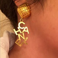CHANEL CHANEL letters clip back earrings I love these earrings! Spelled CHANEL with quilted design, these can be overstated or under, depends on how you rock them! Your style can be overtly CHANEL w/ French twist or wear your hair down at work. CHIC coworkers, only please!  These are thick earrings, wearable, because of the foam backs! I really feel that they're much more comfortable with the foam backing. The foam slides on and off, I can leave on or remove. I'll include the Chanel box you…