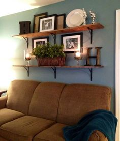 Family Room: Build Unique Statement Using Accessories For Family Room Decorating Ideas Blue Wall Color With Floating Wooden Shelves Using Decorative Pictures For Cozy Family Room Decorating Ideas With Brown Couch                                                                                                                                                                                 More
