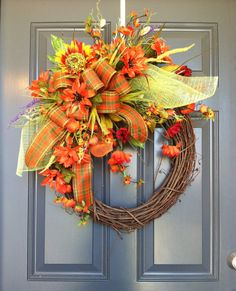 This is a beautiful Fall / Thanksgiving wreath. Grapevine wreath decorated with beautiful fall ribbons and bows and highest quality silk flowers and