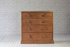 Victorian pine chest of drawers. Two short over three long drawers with later top.   Restored to it's former glory!