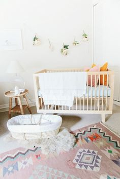 RUG ❤️ Adorable nursery features a modern wood crib and a woven moses basket atop a sheepskin layered over a pink kilim rug Boho Nursery, Nursery Neutral, Nursery Room, Girl Nursery, Kids Bedroom, Baby Room, Nursery Decor, Nursery Ideas, Neutral Nurseries