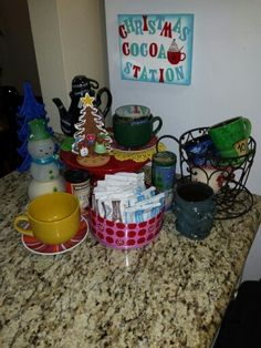 Home made sign on canvas, added magnets to back, add varieties of hot Cocoa, candy canes, sprinkles and display some cute mugs to use! Fun Christmas Times 2014