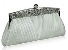 The gorgeous ivory clutch bag has a pageant look with its crystal sparkling frame and V shaped pleated satin body.