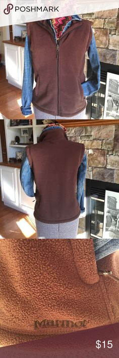 Marmot fleece vest Well constructed fleece vest by Marmot. Full zip front, two zip hand pockets with adjustable drawstring hidden in pocket. Excellent preloved condition. Perfect for layering for added warmth. 🌻 Marmot Jackets & Coats Vests