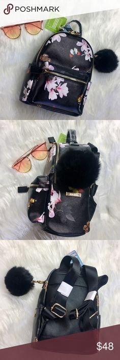 """Pom Mini Backpack Gorgeous vegan leather mini backpack with flower and butterfly patter all over. Gold tone hardware with black fluffy Pom on side. Pom is detachable. Side pockets for quick and easy storage. Backpack measures 12"""" (from top handle to bottom) by 8"""". Bags Backpacks"""