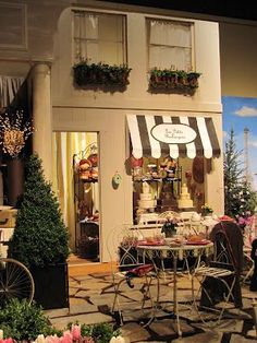 Parisian Theme at NW Flower & Garden Show. Details-window boxes, soda shop table, striped awning.