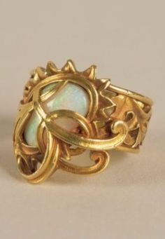 An Art Nouveau opal and gold ring, by Georges Fouquet, circa 1900. After Mucha's 'Peacock Ring' design, exhibited at the Paris Exhibition in 1900. #GeorgesFouquet #ArtNouveau #ring