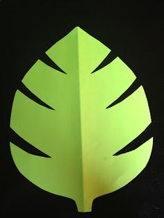 Cut the leaves. I used two different colors of green paper. Regular printing paper or construction paper will work for this. It doesn't have to be thick paper. I folded them in half while cutting to make sure they were symmetrical and to give the leaf a nice crease! I probably cut over 100 leaves. I used them on the vines and I laid them out on the different tables. They added a nice decorative touch.