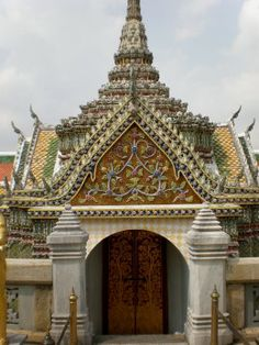 Example of the beautiful and detailed mosaic rooftops that abound in Wat Phra Kaew's Buddhist Complex. Bangkok, Thailand.