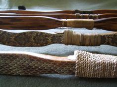 Bows and Arrows | ROOTS School.  Another view of some handle sections. Sarah's locust with python skin is front and center with a sweet cordage handle wrap.