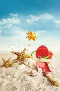 Stock photo: Beach toys on beach against blue sky