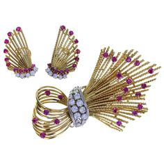 Kutchinsky Ruby Diamond Gold Spray Brooch and Earrings | From a unique collection of vintage brooches at https://www.1stdibs.com/jewelry/brooches/brooches/