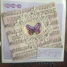 This card was made using sheet music from old hymnal as the background. The butterfly is a Penny Black Sticker & the frame is a Forever In Time sticker.