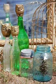 Vintage glass bottles, glass mason jars in aqua and clear, vintage mirror, owl figurines, and bird cage all from Jake's Flea Market in Boyertown, PA.