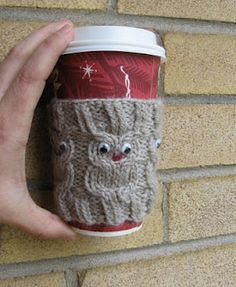 owl coffee cup cozy free pattern (knit it flat, cast on 50, rib for 3 rows, increase by 3 in first row of pattern, make 4 owls, with 3 stitches of knit at each end, make 4 rows of dc on one end, including loops in the last row, sew buttons) to fit on a mug