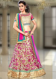 Look trendy in this Beige and Pink #net #Lehenga crafted with Floral Print, Stone, Zari, Sequins and Patch Border Work. As shown, Beige and Pink art silk Choli and Pink net Dupatta