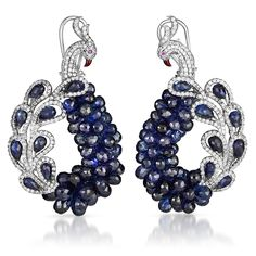 Stunning peacock earrings of blue sapphire, colorless diamonds, and rubies set in white gold. Inspired by the exotic birds of the Far East.