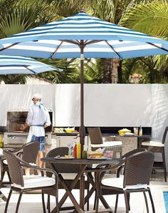 Add style and shade to your poolside space with the Striped Cobalt Designer Umbrella; a completely customizable and fade-resistant piece perfect for days by the pool.