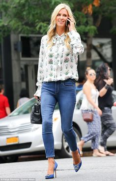 Stylish as ever: Nicky certainly looked fashion savvy in that fauna-inspired blouse, skinn...