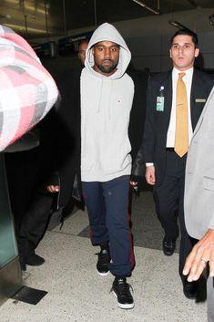 Kanye West wearing Yeezy Season 3 Hooded Shearling Jacket in True Onyx, Yeezy Season 4 Calabasas Sweatpants, Adidas Yeezy Season 4 Calabasas Sneakers and Champion Reverse Weave Hoodie Sweatshirt