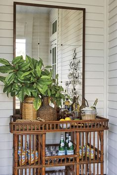 Details to Notice: 2019 Southern Living Idea House - Emily A. Clark A big mirror above a pretty bar cart always makes for a nice porch vignette and opens up the space.<br> A tour of the 2019 Southern Living Idea House and the details worth noticing. Southern Cottage, Southern Living Homes, Southern Porches, Country Porches, British Colonial Decor, British Decor, Estilo Tropical, Vintage Industrial Lighting, Old Houses