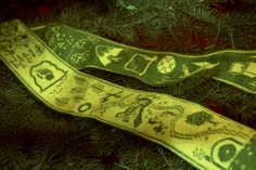 This reversible scarf bears a pictorial retelling of The Hobbit