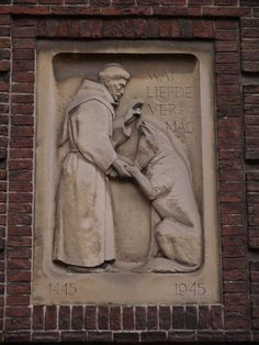 Description: Leiden, Netherlands: Hartebrugkerk: St Francis of Assisi (Sint-Franciscus) and a dog ('Wat Liefde Vermag') (1945)