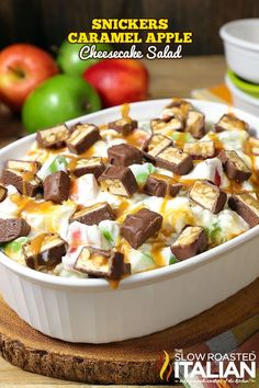 Snickers Caramel Apple Cheesecake Salad is a simple recipe that comes together with just 5 ingredients. Tart and sweet crisp apples are folded into the most rich and luxurious cheesecake filling and topped with caramel and Snickers to create an amazing fruit salad that will blow your mind!  Your family will go nuts over it.