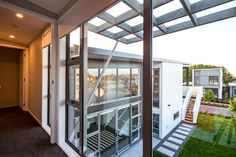 Large Windows naturally let you see the ceiling of one room continue into another, giving the illusion of a bigger space. Universal Homes at Hobsonville Point
