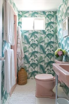palm print bathroom, pink toilet!