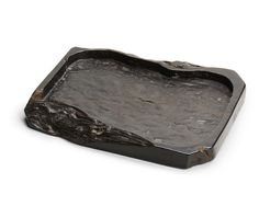An ironwood tray for incense China, 18th-19th century Rectangular, with vertical interior walls and carved to resemble an inkstone 11 3/4 x 14 5/8 x 1 1/2in (29.7 x 37.1 x 3.8cm)