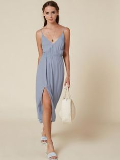For work, weekend or wherever. This is a calf length dress with an elastic waist, adjustable straps and a high slit.