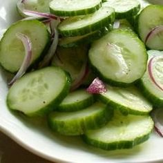Cucumbers Sliced cucumbers and sweet onion marinate in a sweet and tangy combination of vinegar and sugar in this refreshing salad.Sliced cucumbers and sweet onion marinate in a sweet and tangy combination of vinegar and sugar in this refreshing salad. Pickled Cucumber Salad, Marinated Cucumbers, Cucumbers And Onions, Pickling Cucumbers, Ketchup, Salad Vinegar, Rice Vinegar, Cucumber Recipes, Salad Recipes