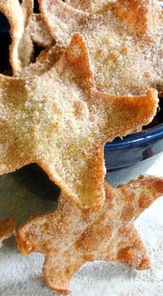 Super Easy Cinnamon Stars - won ton wrappers fried crispy and covered with cinnamon and sugar make an easy and fun dessert when paired with fruit and dip!