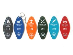 """An adaptation of classic hotel key tags. Available in six different designs, each based on nostalgic extra-curricular clubs and activities. Please note that your membership number is exclusive with no two alike in any club. Please note tags may have very minor surface marks due to age-old manufacturing process. Tags measure 4.75"""" x 2.125"""" and come with metal c-ring. Made in the USA."""