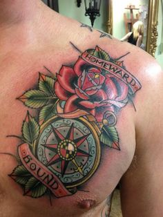 Exciting design of Rose and Compass Tattoo Old Compass with rose and leaves design, a medium size tattoo on the chest.  - Download