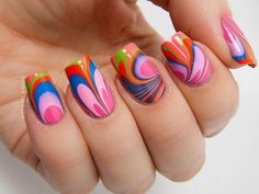 Ever wonder what would happen on your nails if you ever dipped them in rainbow? This is what you can get. Swirly, crazy and bold shapes of water marble nail art. It's a candid looking design that simply states how open and free you are this summer.